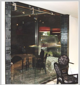 The exquisite look of glass with barn door style hardware... Tempered low iron glass for improved color & clarity...